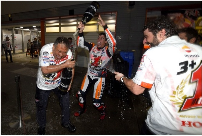 HRC vice president Shuhei Nakamoto gets soaked during Marquez title celebrations, Japanese MotoGP